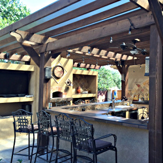 outdoor kitchen with pergola for gilday construction in manchester tn